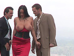 Her Huge Hooters Swing As She Takes On Two Guys At Once