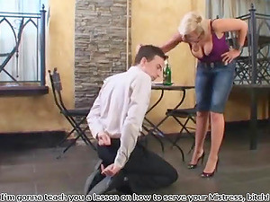 Classy Cougar Enjoying Drink While Her High Heels Is Licked