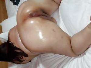 Oiled Up Latina With Huge Shaved Pussy