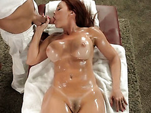 Sexy Tanned Oiled Up Red Head Gives Eager Blowjob In Massage Parlor