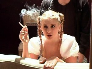 Pigtailed Blonde Gets Hammered From Behind While Smoking A