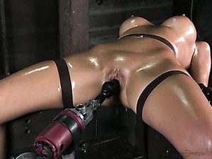 Milf Covered In Oil As She Takes A Toy Fucking