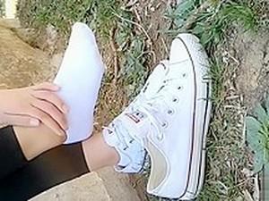 Chinese Girl Sprains Foot In White Ankle Socks And Black Leggings