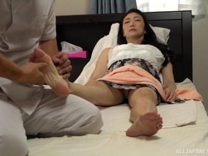 Hidden Cam Filming A Japanese MILF Getting A Feet And Pussy Massage