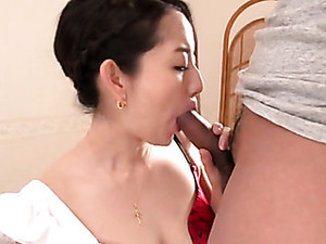 Asian Maid On Her Knees Servicing Cock