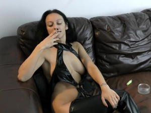 SMOKING IN LEATHER BOOTS AND OUTFIT - Cassie Clarke