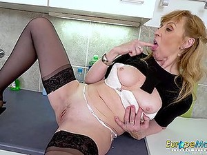 Sexy Granny In Her Kitchen Finger Fucking Her Old Pussy